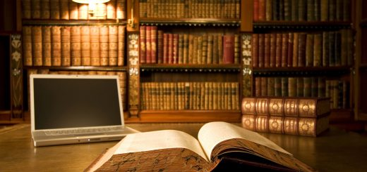 Laptop in classic library with books in background series
